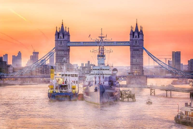 Tower Bridge and boats at River Thames in London, UK