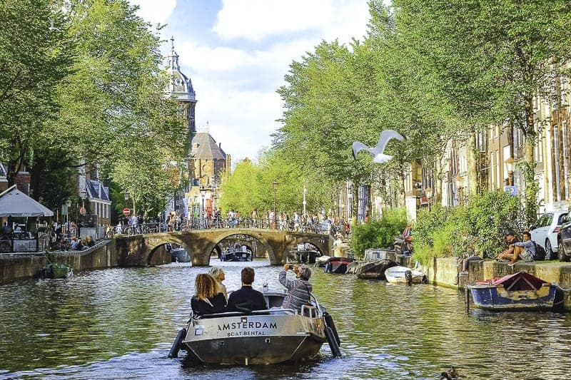 Travellers are enjoying cruising with a boat in Amsterdam