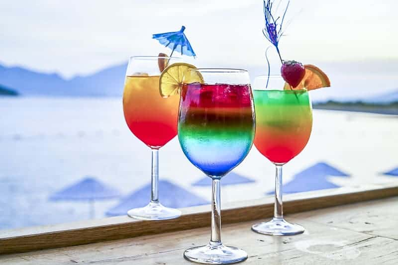 Three cruise drink cocktails at waterfront