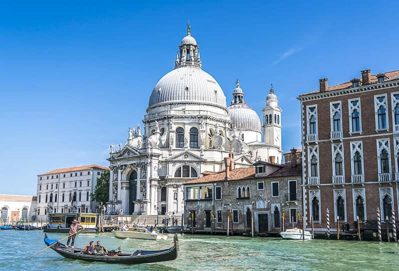 A Basillica and canal with a gondola in Venice, Italy