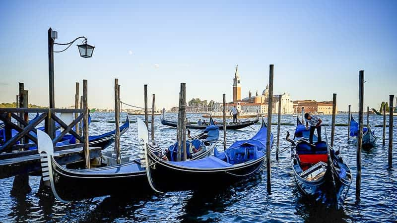 Beautiful blue gondola floating on water in Venice, Italy