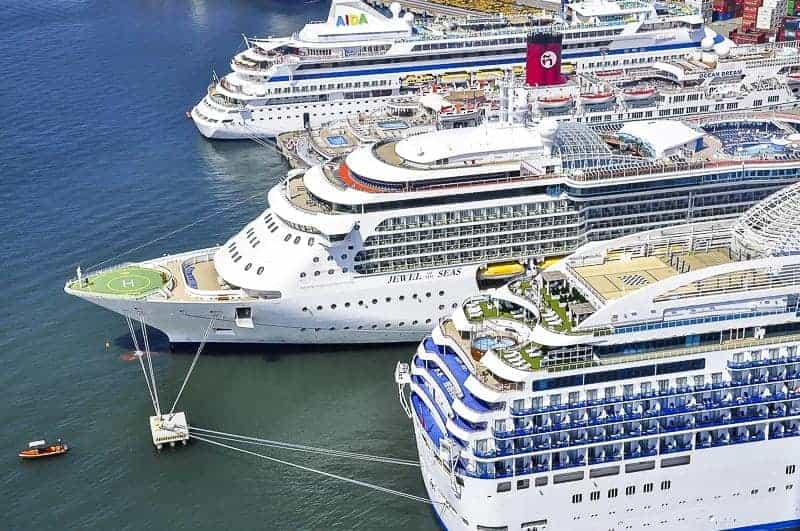 Three Cruise Ships are docking at a Port