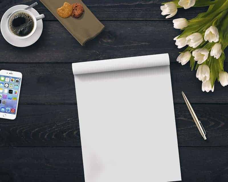 What Kind of Blog Should You Write  with paper, pen and flower