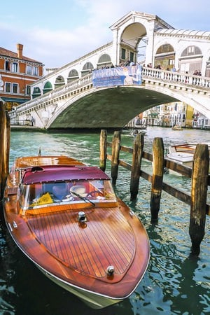 A water taxi floating on the river in Venice, Italy