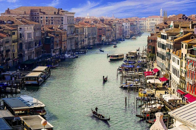 Beautiful Venetian landscape with river, buildings and gondola in Venice, Italy