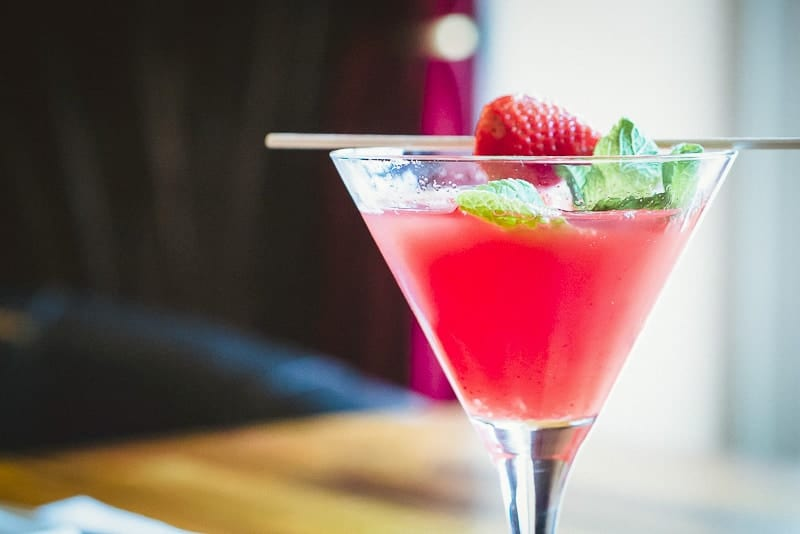 Cruises with Free Drinks and having a Beautiful Red Cocktail