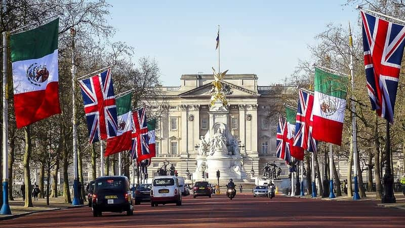Flags and a gate at Buckingham Palace in London, UK