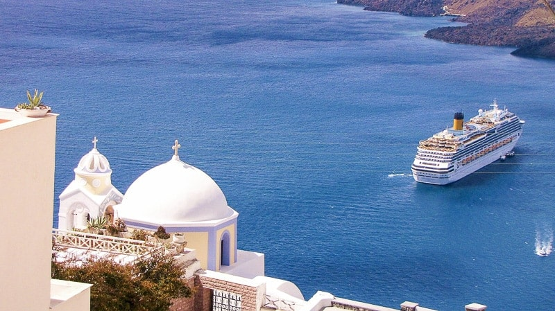 A Cruise Ship in Santorini, Greece - WIFI on a Cruise: Onboard Internet Access (Complete Guide)